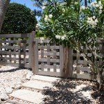 Unique reclaimed  cypress woven fence and gate .. no staining and sealer .Fence and gate weathered to a gentle silver grey . Anna maria ,Florida